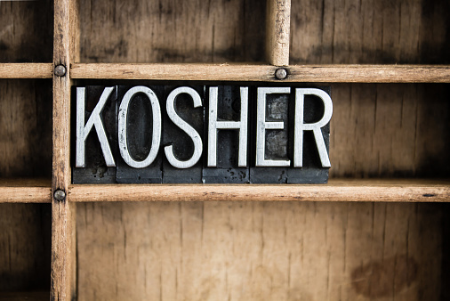 kosher in metal letters on wood background