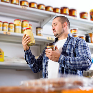 man choosing a nut butter