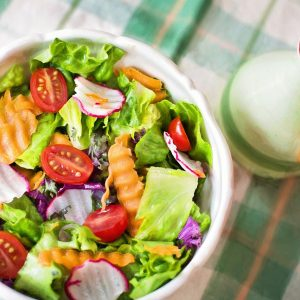 salad with bottle of dressing