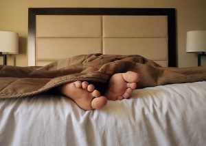 Feet sticking out from the bed covers